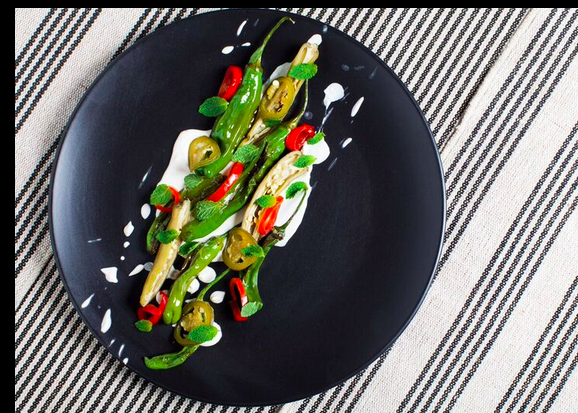 Grilled, pickled and raw chilis with macadamia yogurt and spearmint. Courtesy of Plant Food and Wine.